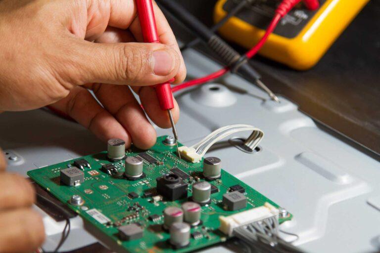 Electronic technician servicing a circuit board